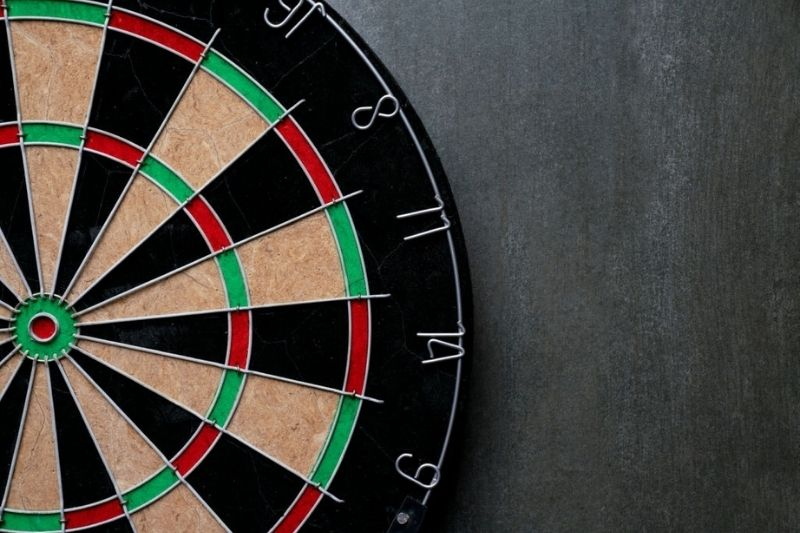 A dartboard hanged on a wall.
