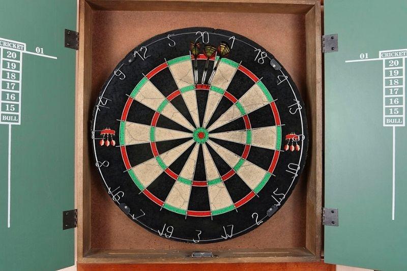 A dartboard cabinet with a steel tip dartboard and scoreboard.